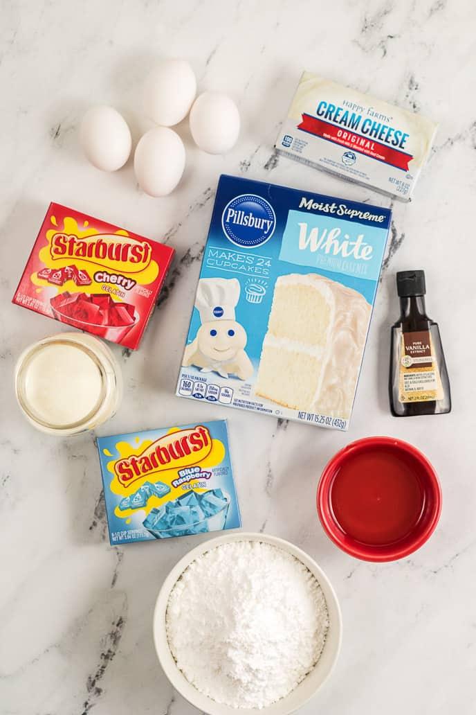Cake mix, jello boxes, eggs and ingredients to make jello poke cake.