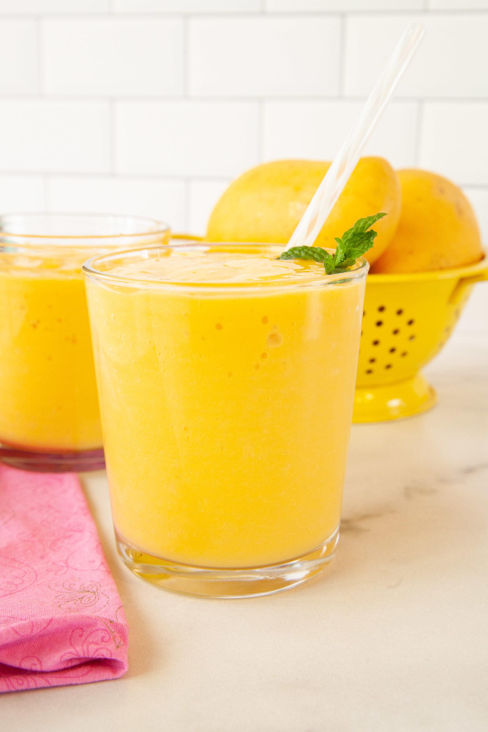 Closeup on a glass of mango smoothie.
