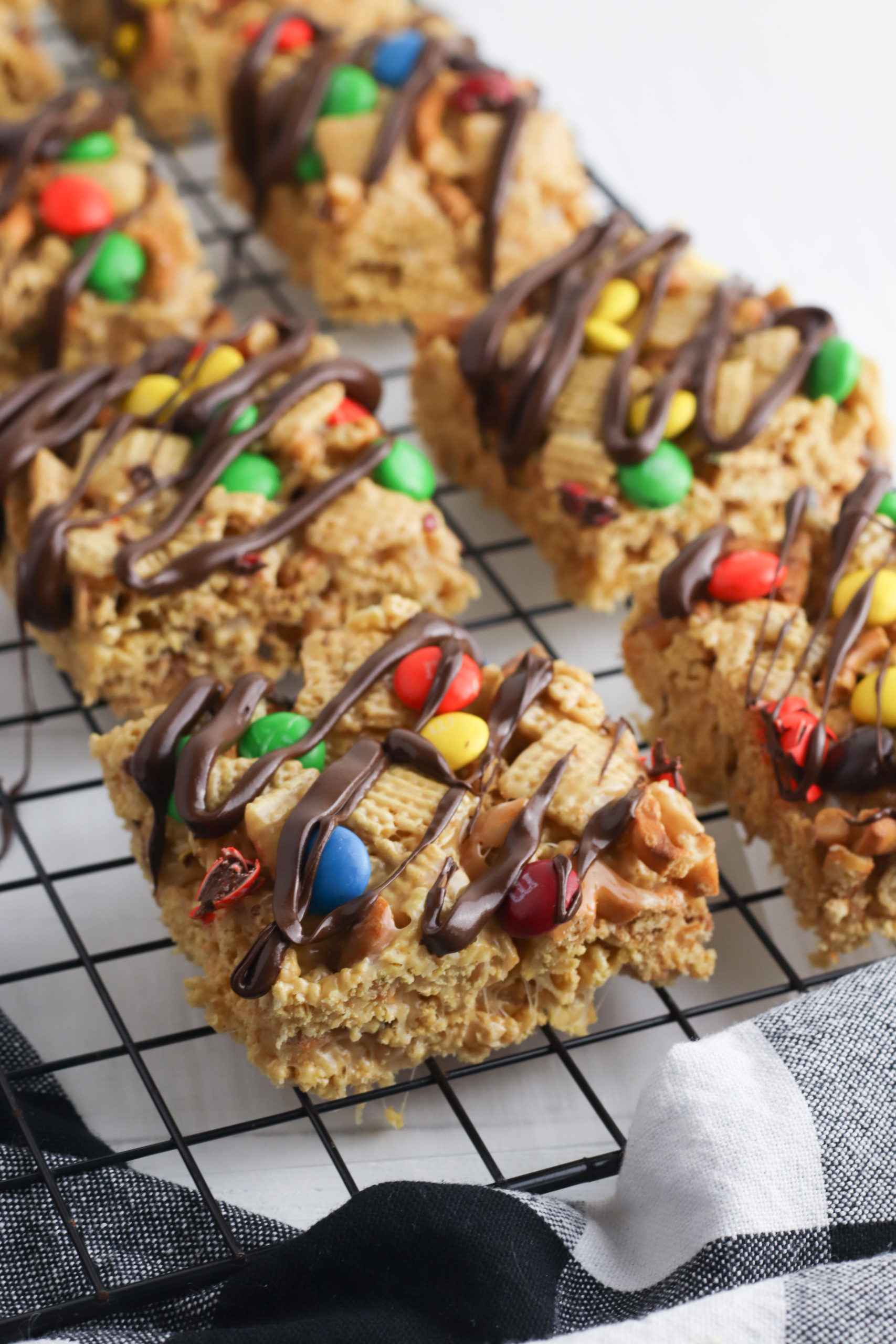 Rack with cut squares of Peanut Butter Chex bars.