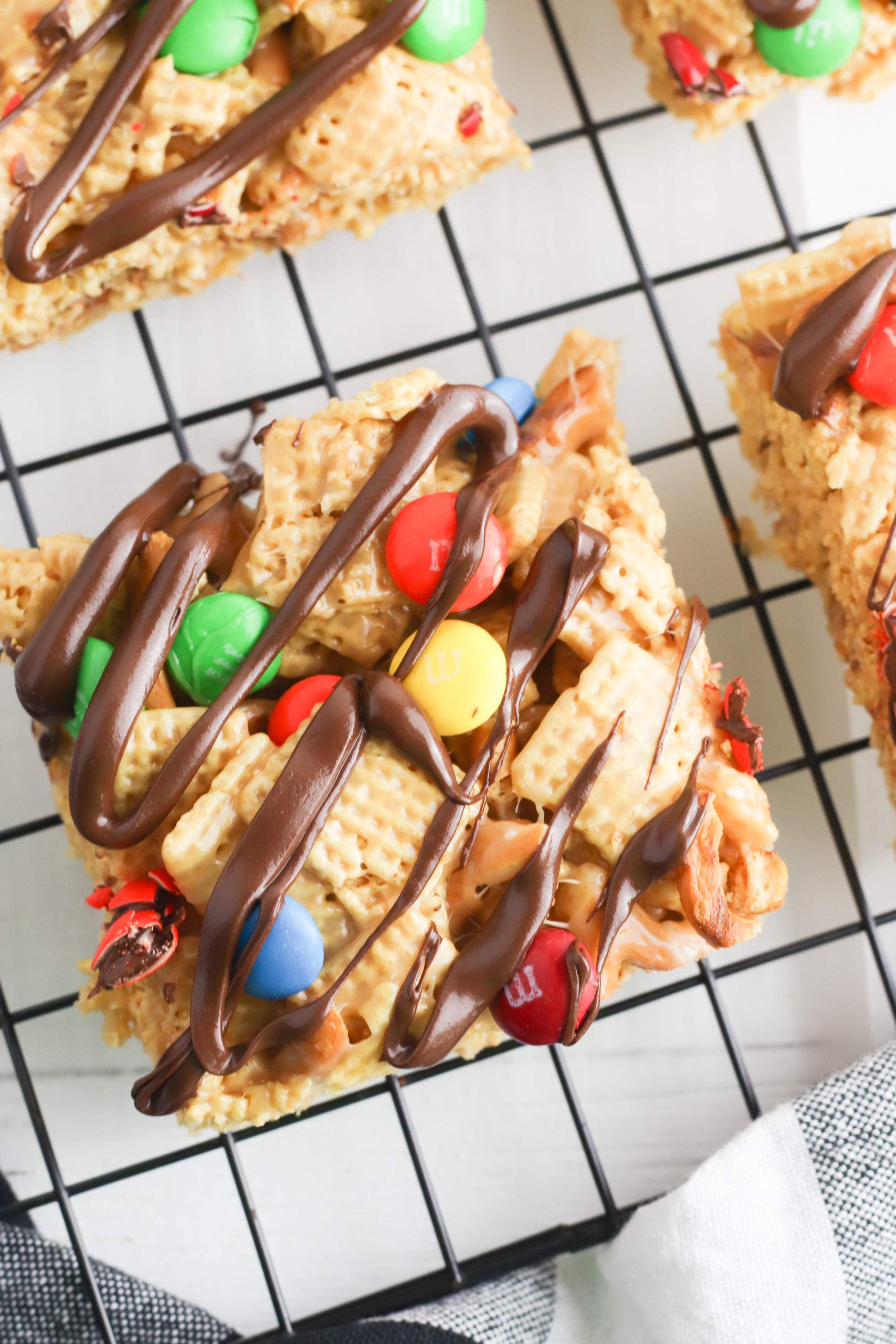 Close up of a peanut butter chex bar with chocolate drizzle.