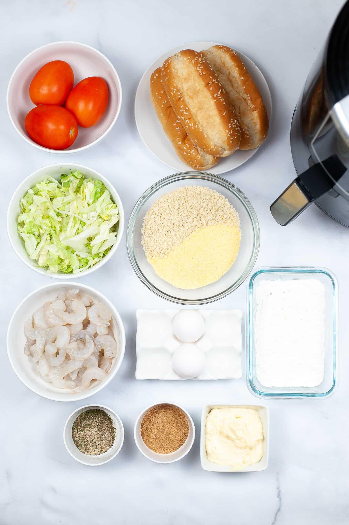 All components necessary to make shrimp po boy sandwiches. Shrimp, rolls, lettuce tomato, coating and seasoning.
