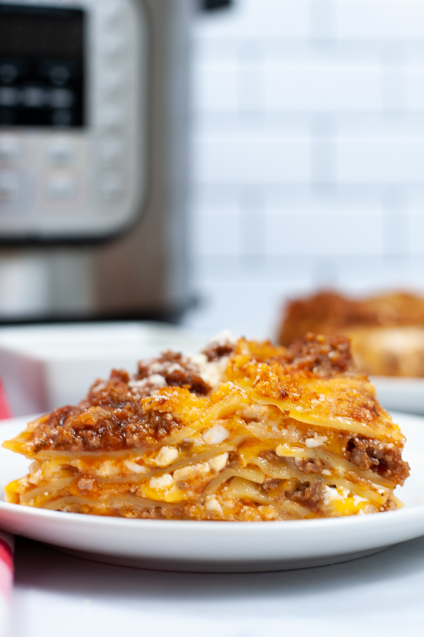 Close up of the lasagna on a white plate.