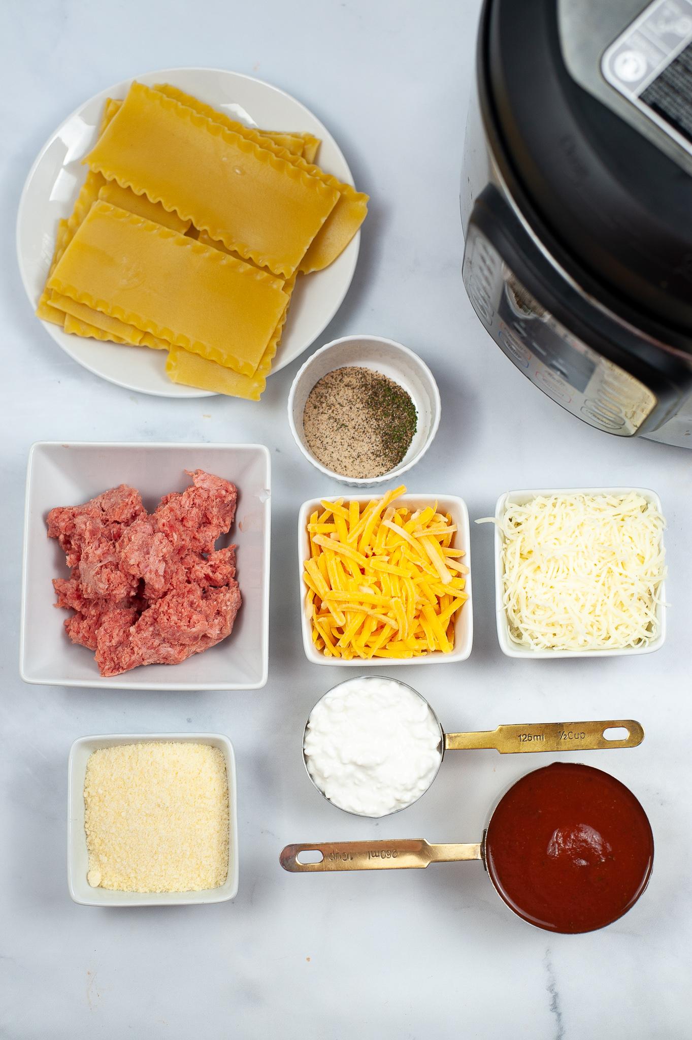 Pasta sauce and ingredients to make lasagna.
