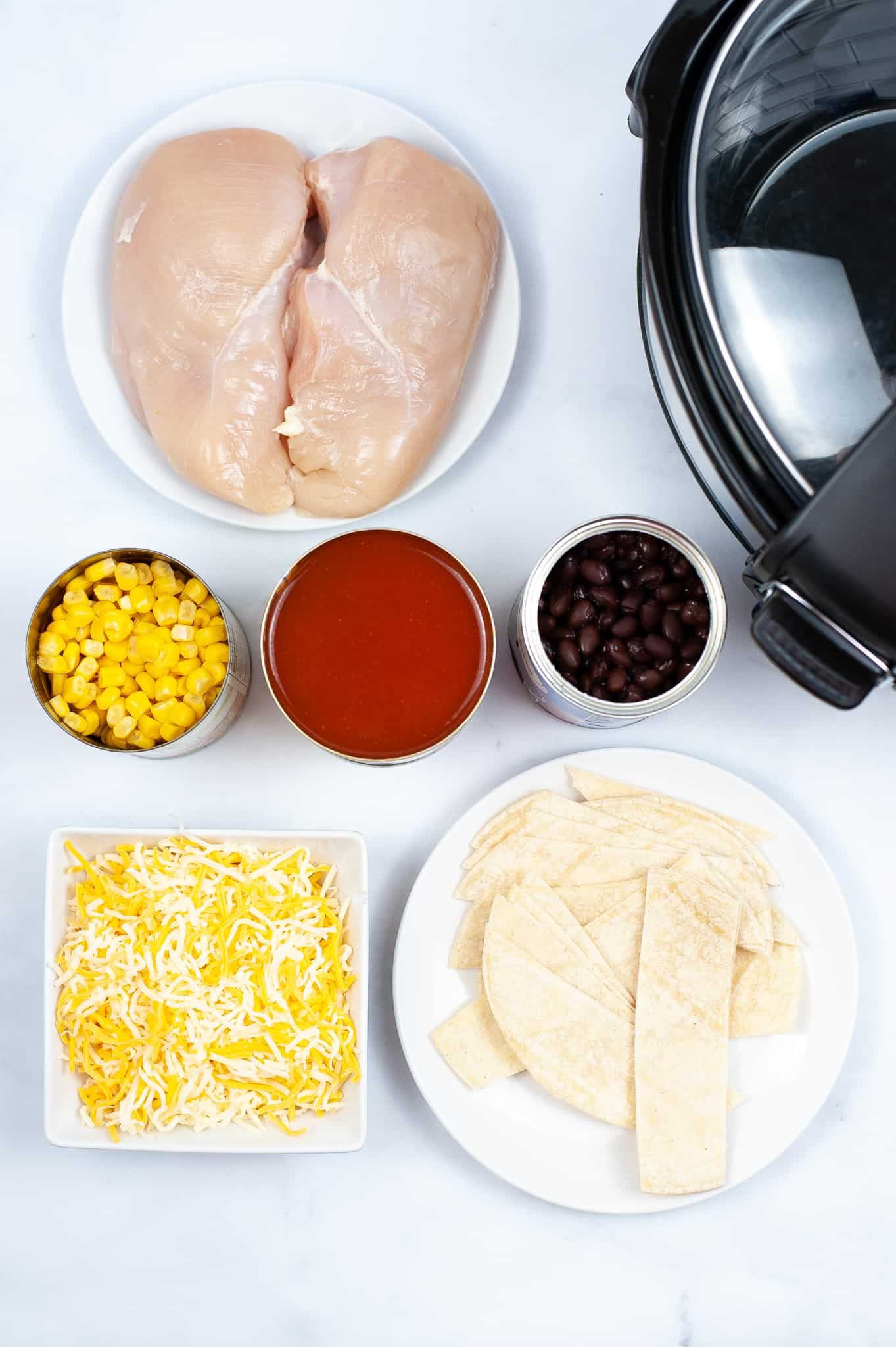Chicken, corn, black beans and enchiladas sauce.