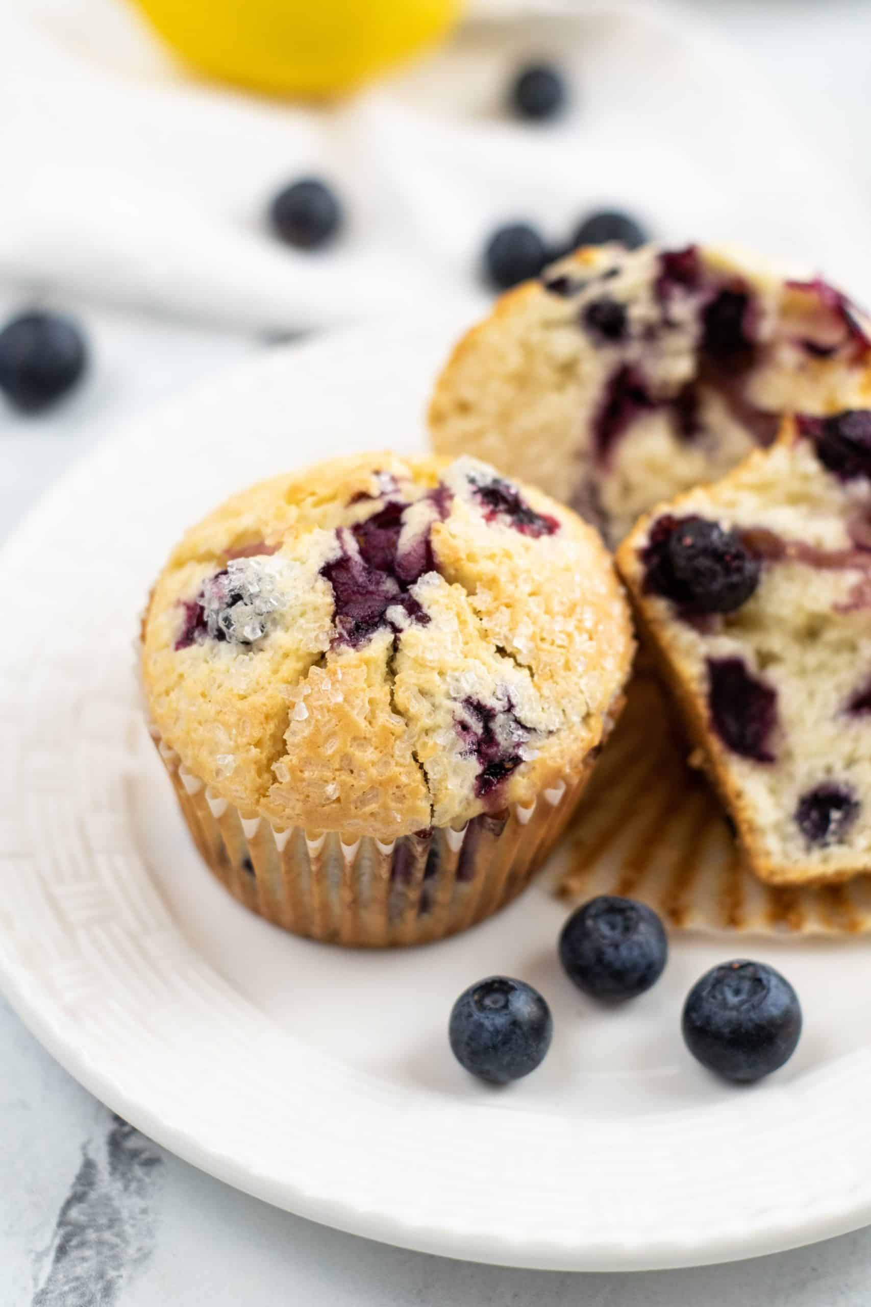Close up on the blueberry muffin with blueberries on side.