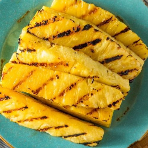 Aqua plate with wedges of Grilled Pineapple.