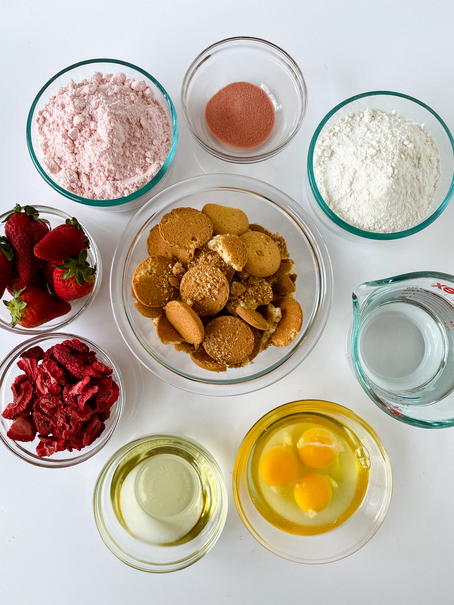 Cake mixes, strawberries, eggs and ingredients needed to make the cake.