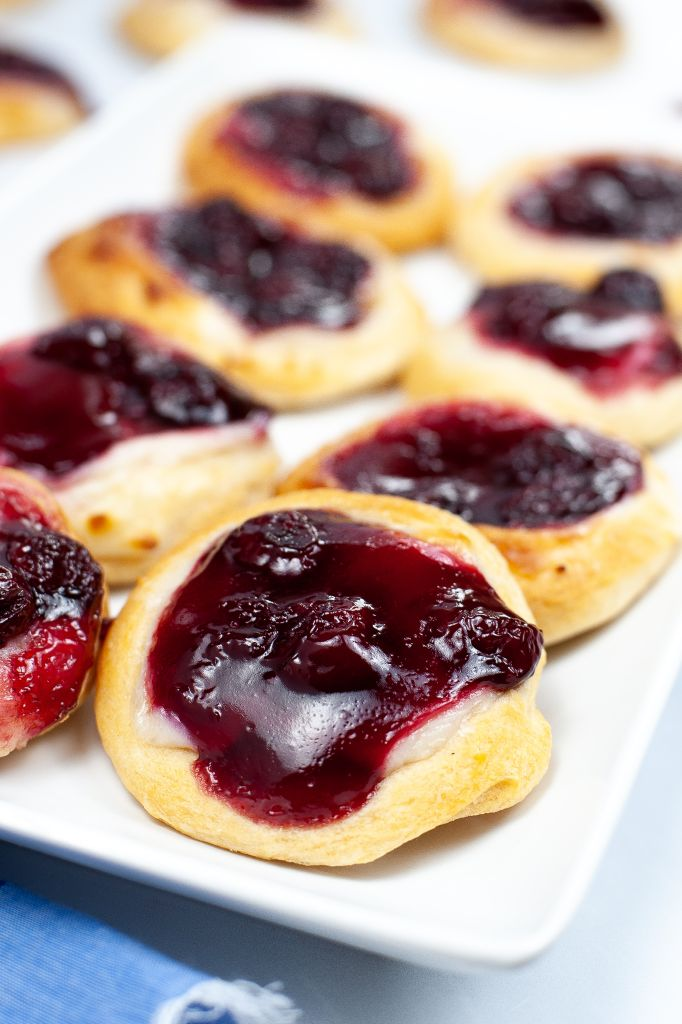 Close up of a plate of cherry danish.