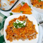 Top shot of the dorito chicken casserole with sour cream and cilantro.