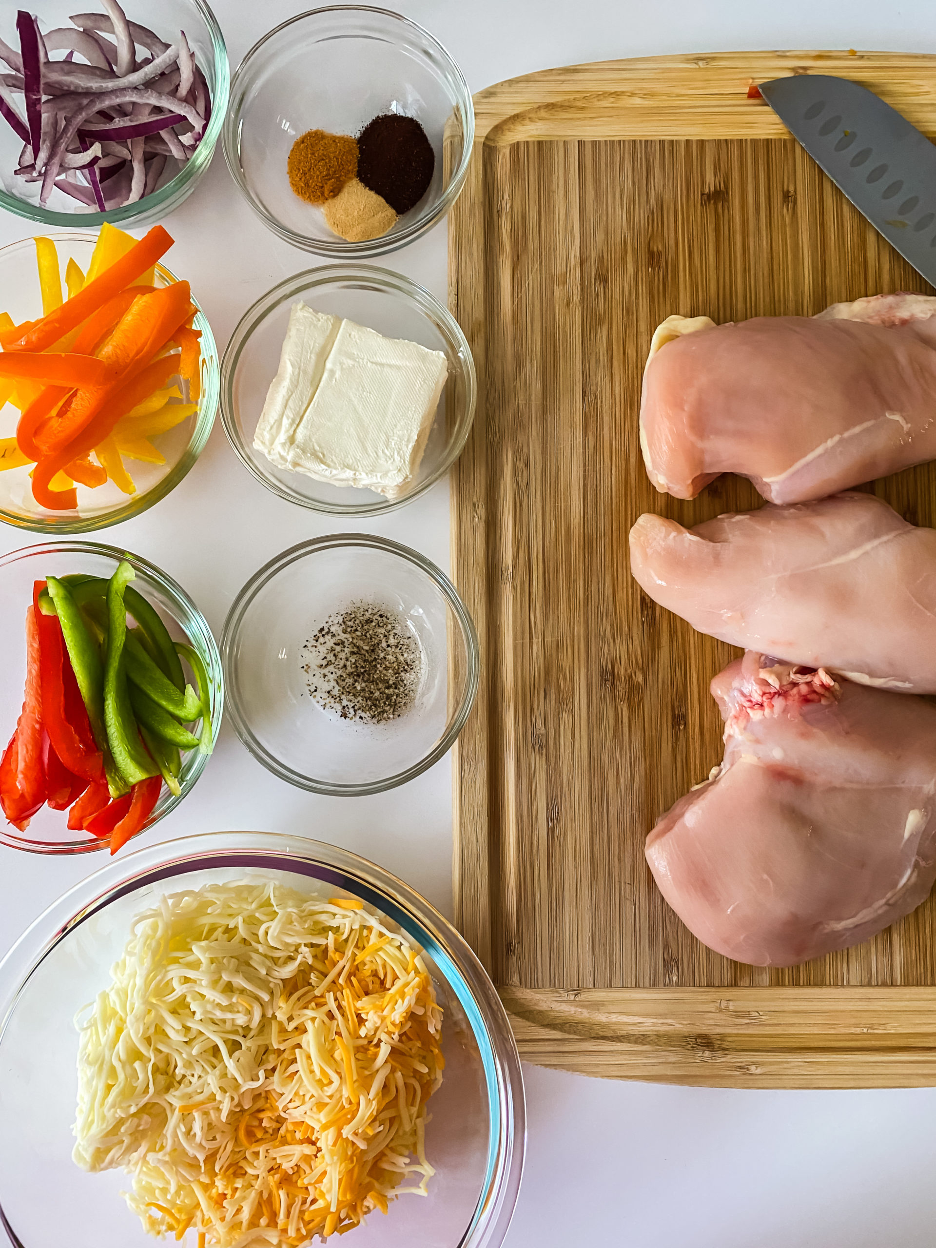 Chicken, cheese and vegetables needed to make stuffed fajitas.
