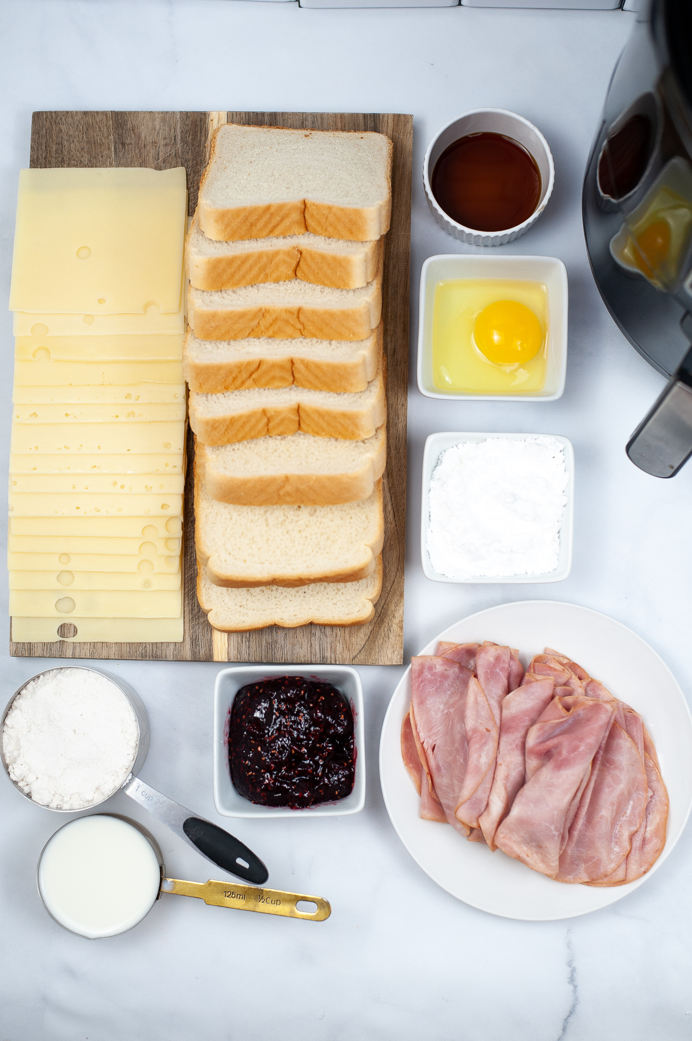 Turkey, cheese, bread, eggs, jam and ingredients to make sandwich.