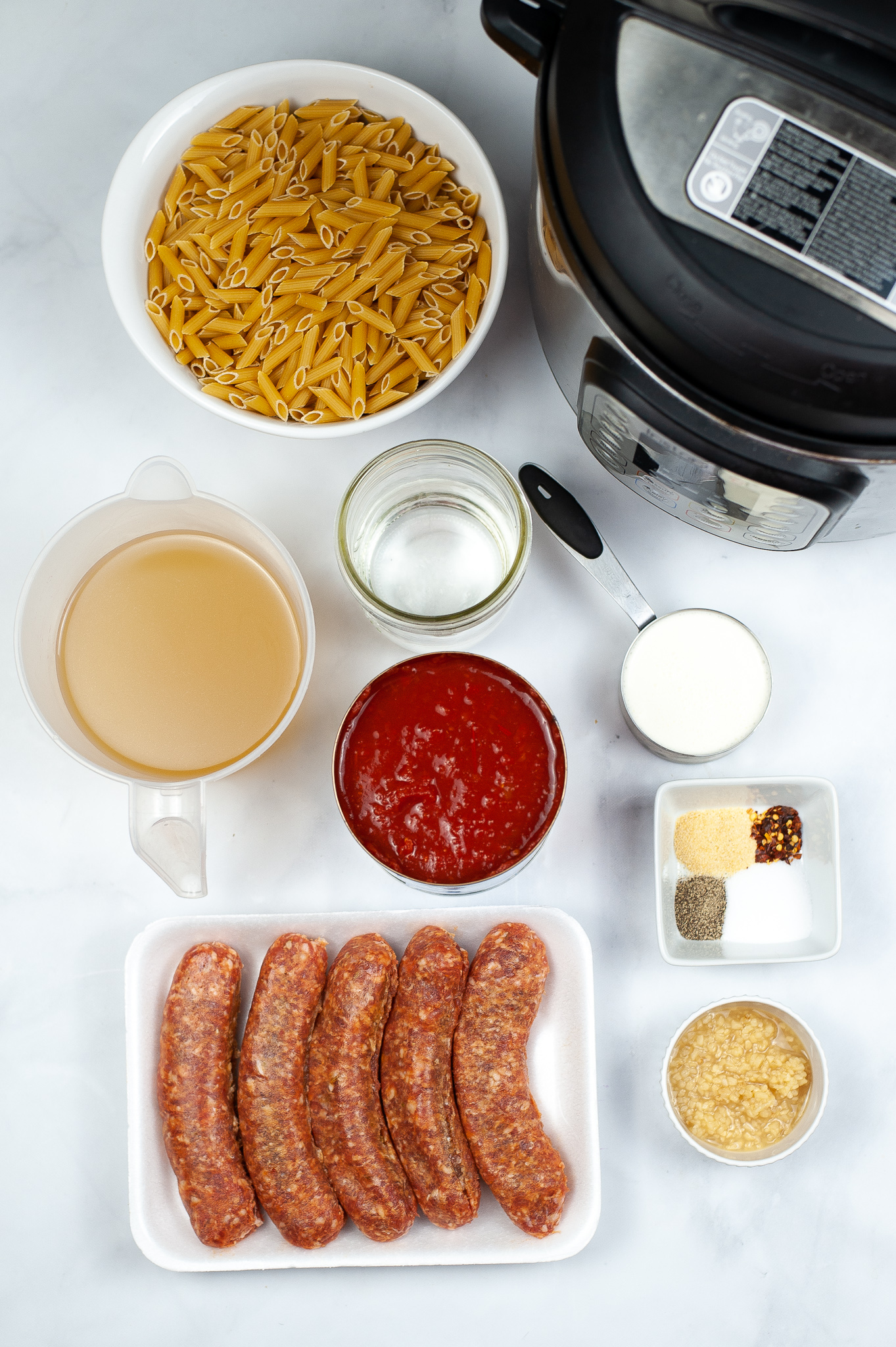Sausage, sauce, chicken stock and all the ingredients need to make Penne Vodka Sauce.
