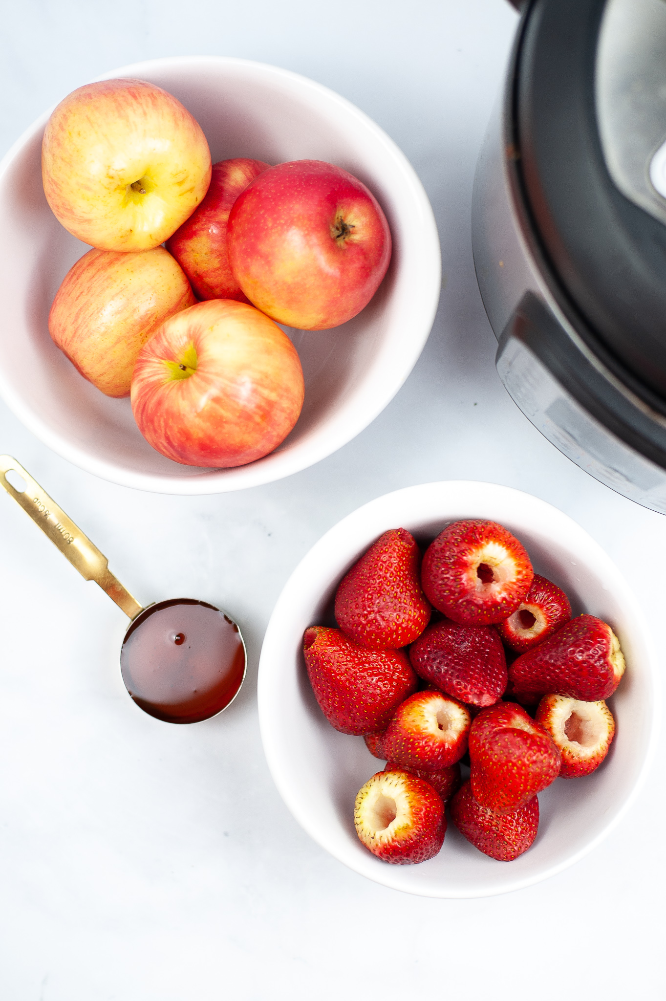 Apples and strawberries with water.