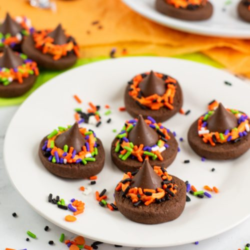 White round plate with Witch Hat Cookies.