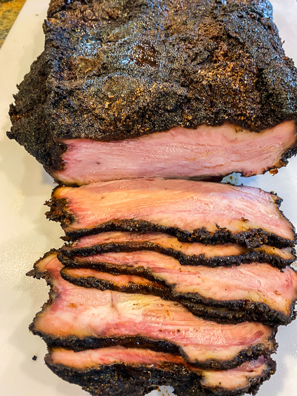 Shot of Smoked Brisket with several slices cut.