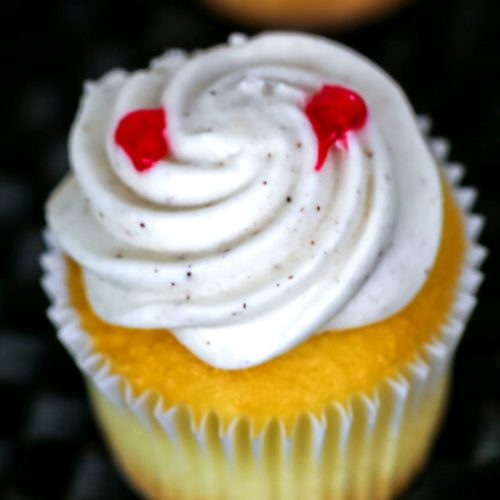 Vampire cupcake with white frosting.