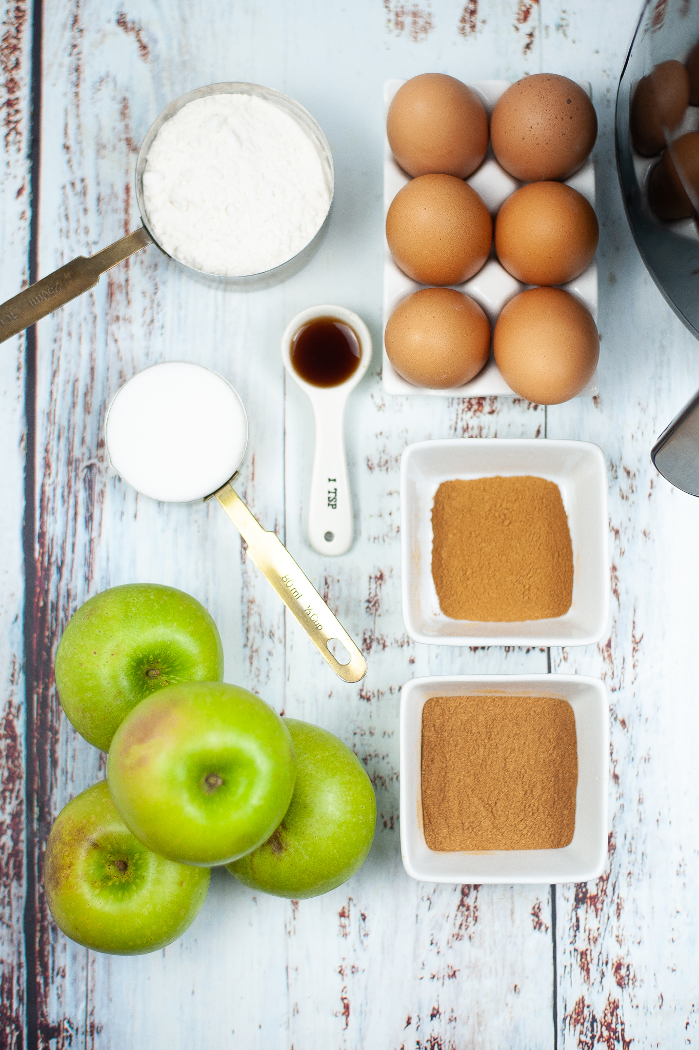 The aples, eggs, spices, flour and vanilla needed to make Pumpkin Spice Air Fried Apples.