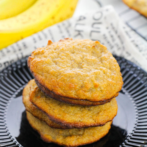 Banana Bread Cookies om a black plate stacked high.