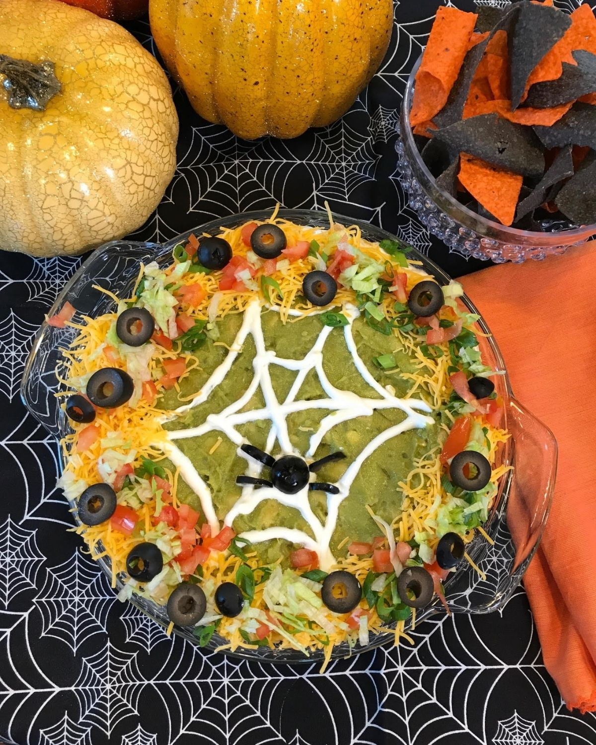 Taco dip with a cobweb on top.