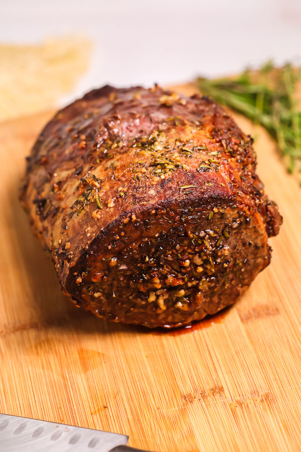 Roasted eye of round roast on a cutting board.