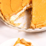 Double-Layer-Pumpkin-Pie a whole pie with a cut taken out of it.