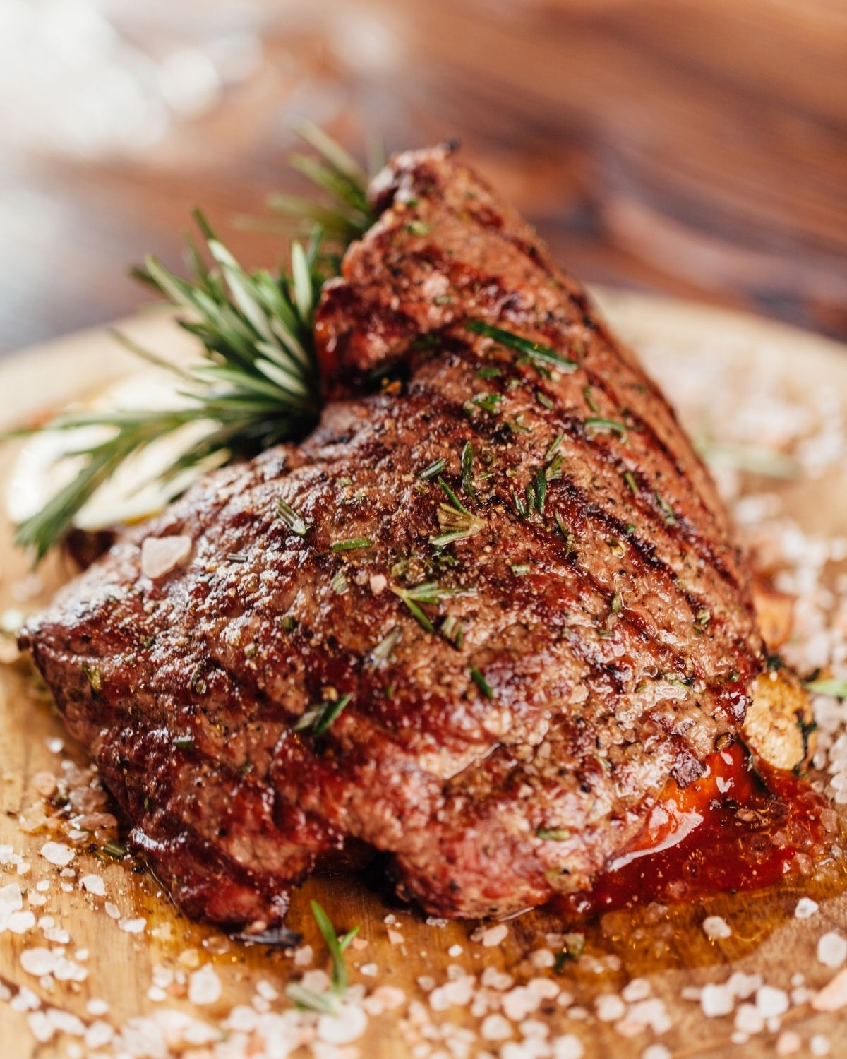 Steak with rosemary sprig on a plate