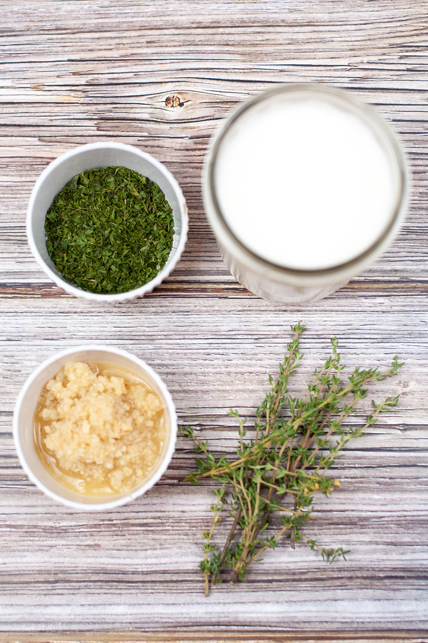 Milk and herbs to create butter.